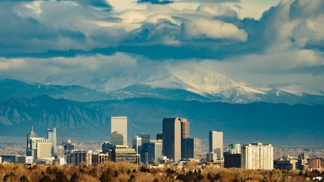 Denver Skyline with Mountains in the background.